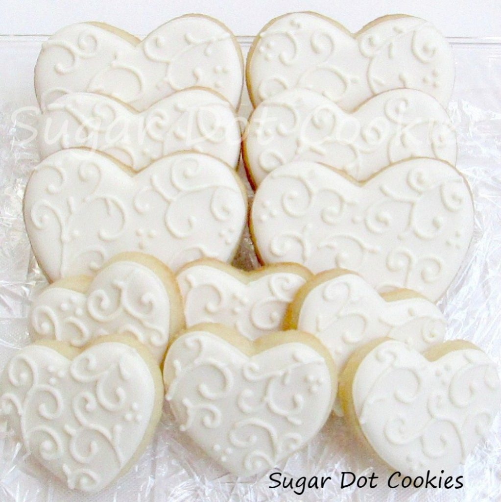 wedding heart sugar cookies royal icing decorated white on white vines scroll